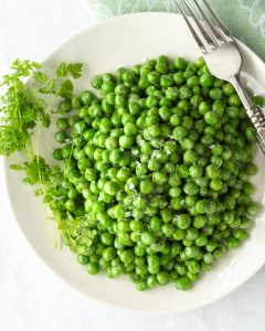 peas with herbs in a white bowl