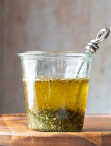 Jar of pesto herb oil