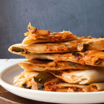 a stack of quesadilla on a plate