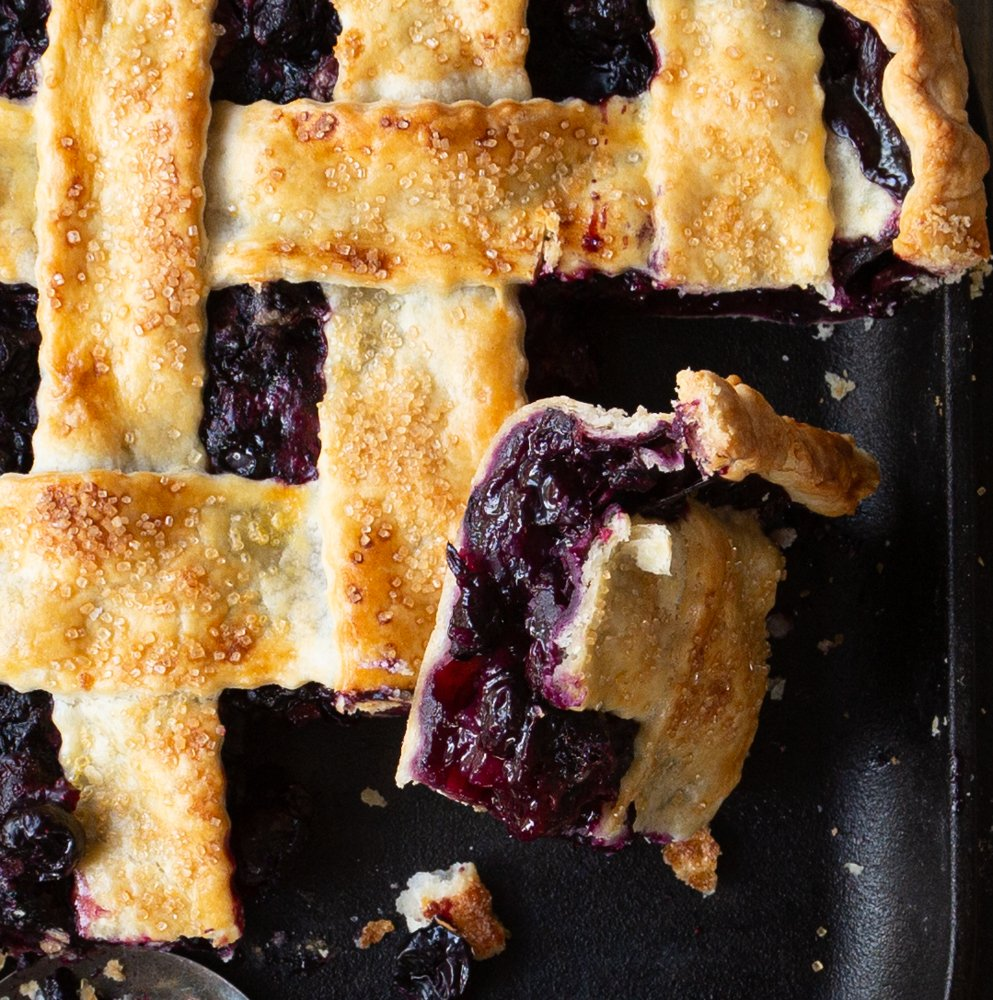 A slice of blueberry ie on a plate