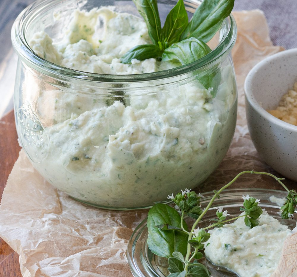 Store-bought ricotta blended with fresh herbs, garlic, cheese, and seasonings is so easy to make at home. Deliciously creamy with a bright, fresh, herby flavor. It goes great on everything!