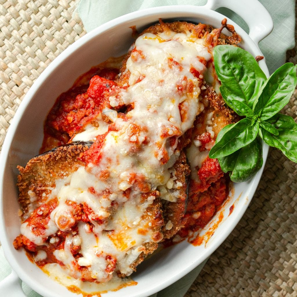 Restaurant Style Eggplant Parmesan is savory, crispy and crunchy. Fresh and bright with homemade Marinara. It's served individually with cheese broiled to perfection.