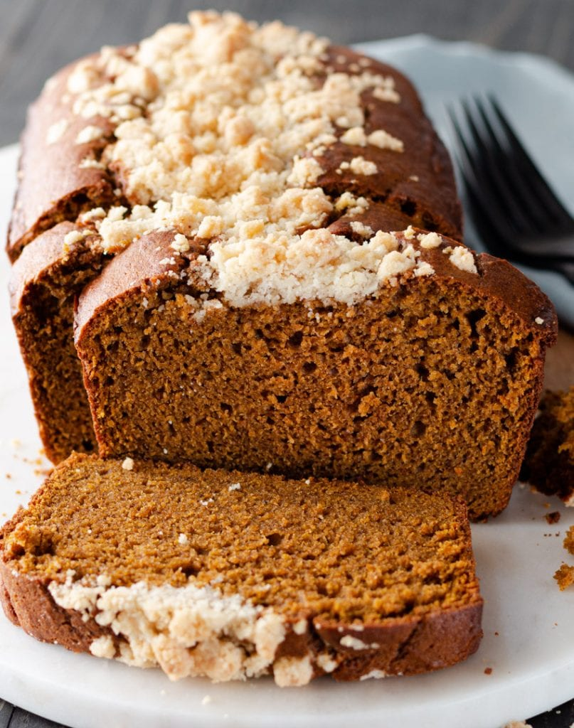 A plate of pumpkin spice bread with streusel crumb topping.