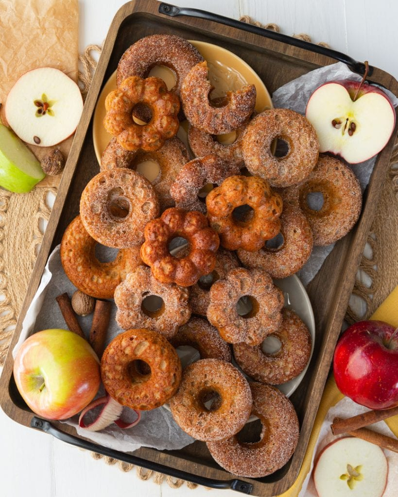 A tray piled high with apple cider donuts