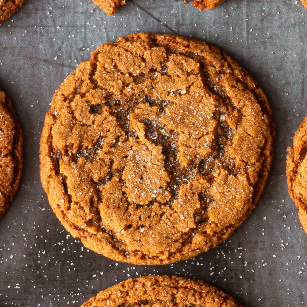 A tray of baked ginger molasses cookies