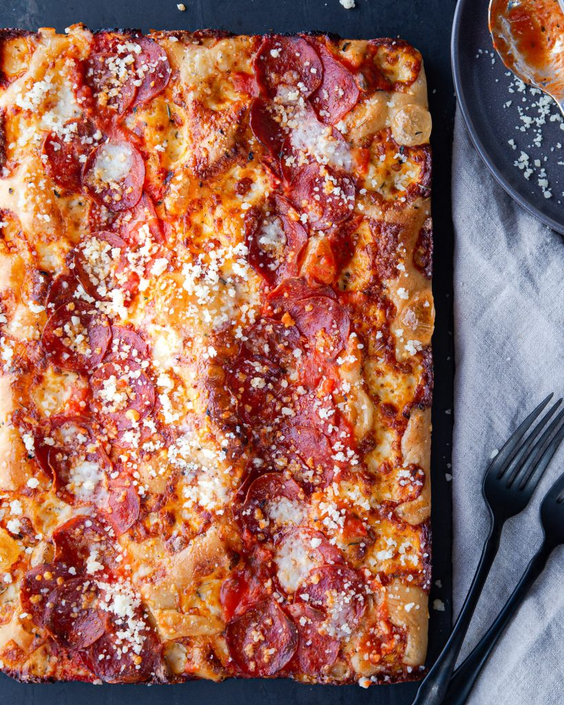 A pan of Detroit Style Red Stripe Pizza.