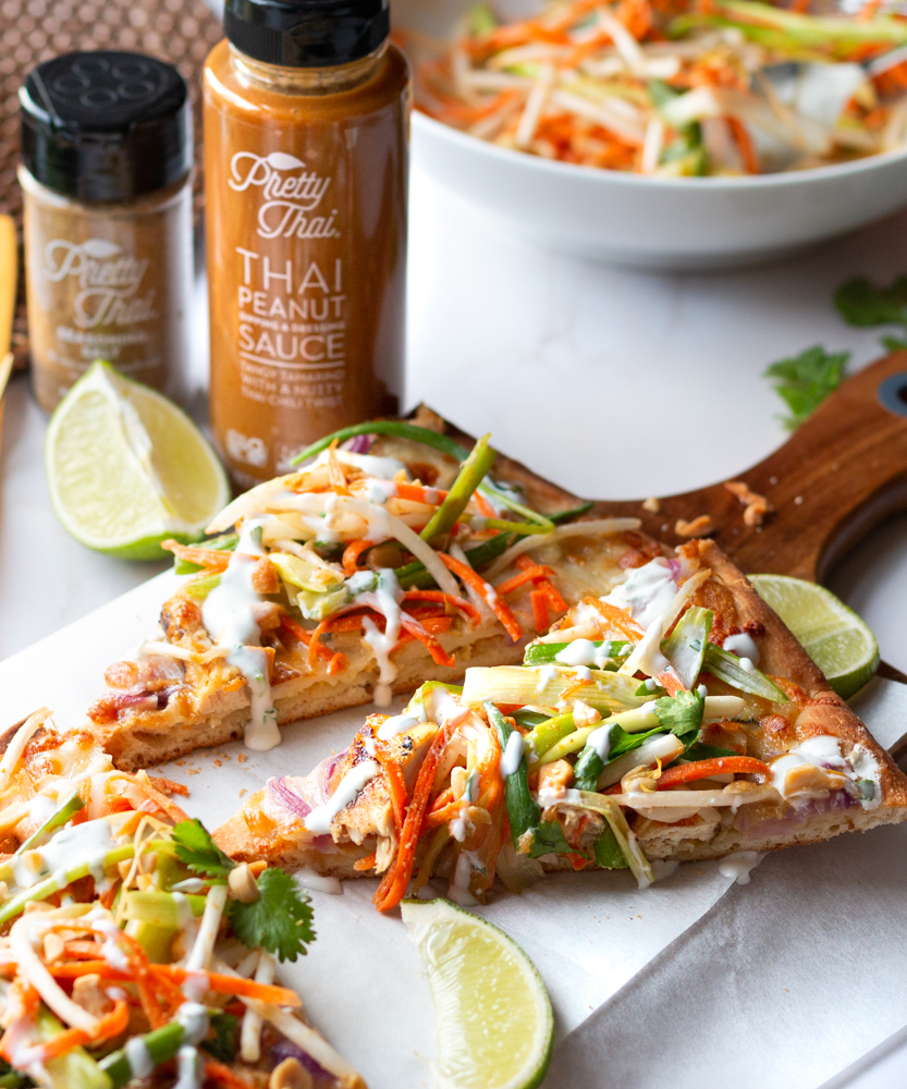 Thai Flatbread Chicken Pizza with Crunchy Thai Slaw and a bottle of Pretty Thai Peanut Sauce